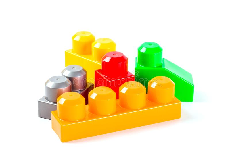 Coloured plastic building blocks. Isolated on white background royalty free stock images