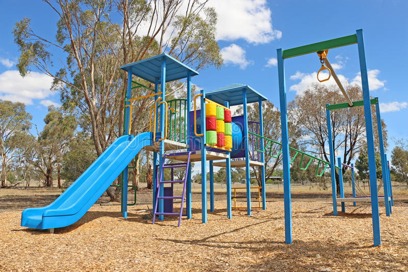 Coloured playground and gym equipment royalty free stock photos