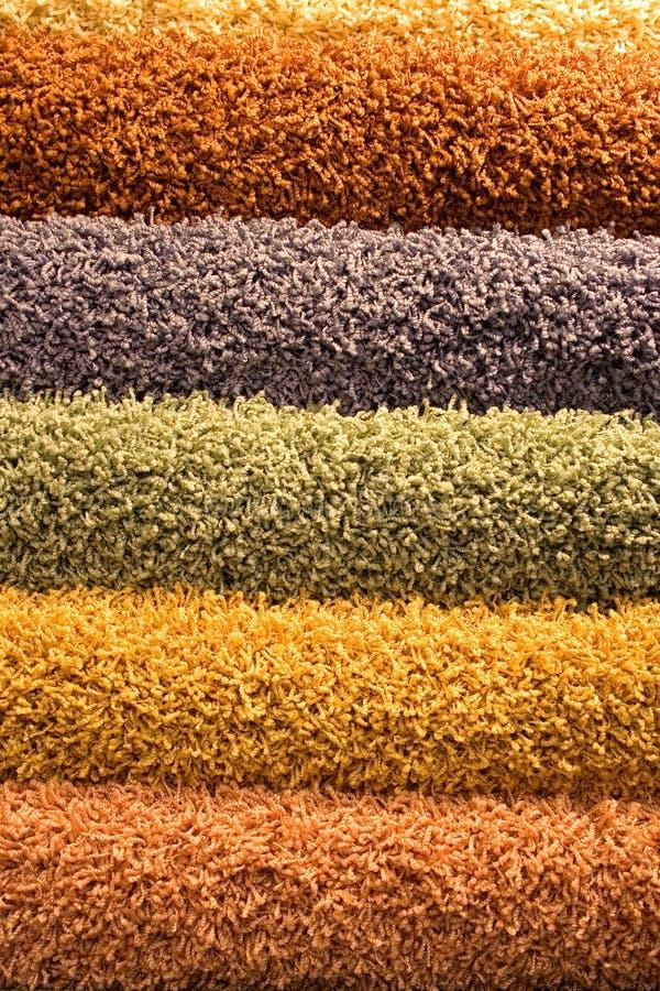Coloured puszyści dywany fotografia royalty free