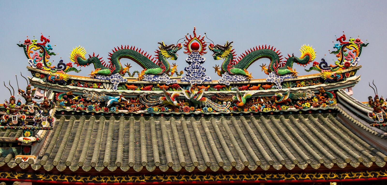 Coloured roof of a hindu temple with dragons.  royalty free stock photos