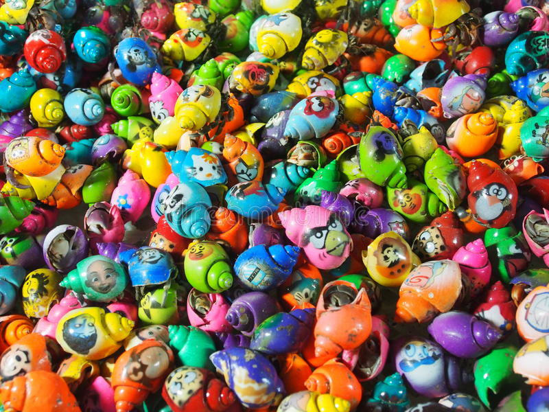 Coloured shells with Angry Birds´s faces stock photo