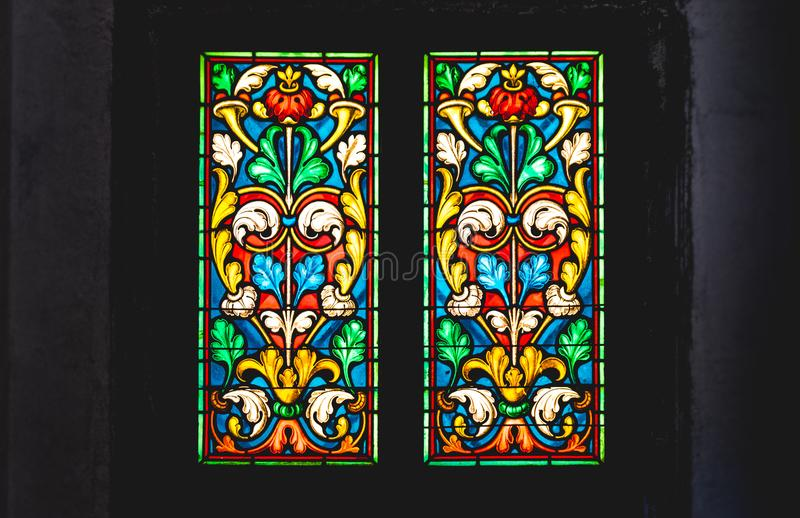 Coloured stained glass in dark background. Coloured stained glass in a dark background stock image