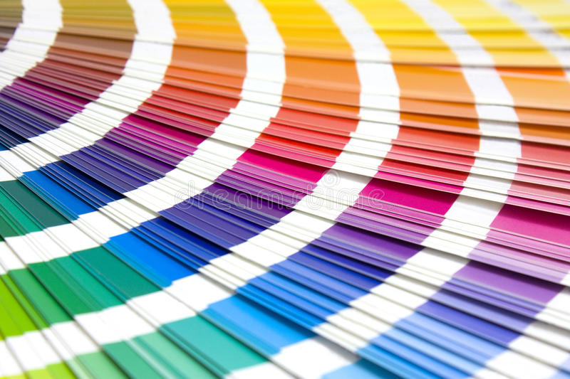 Coloured swatches book. Open showing an array of rainbow colours royalty free stock images