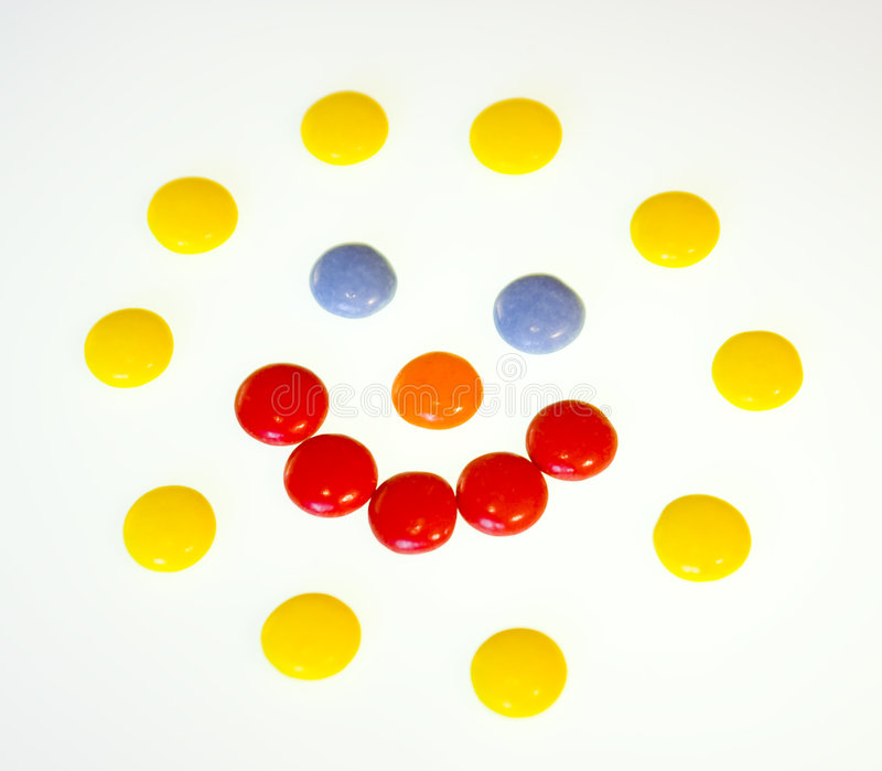 Coloured sweets. On white background stock images