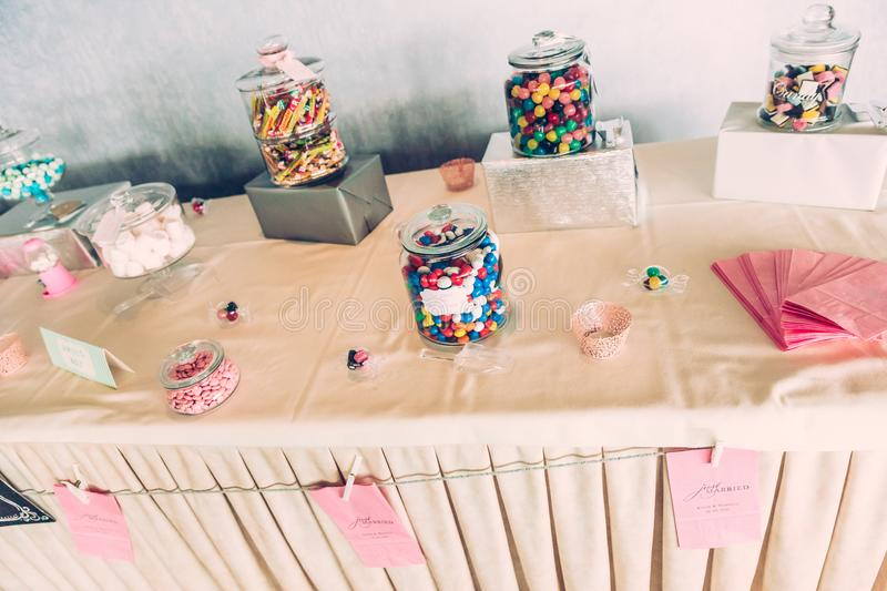 Coloured Sweetsm Wrapped Present Boxes on Sweets Bar Table stock image