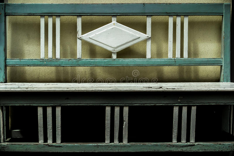 Handcraft old wood bench. Beautiful handcraft wood bench painted with aquamarine and white paint royalty free stock image