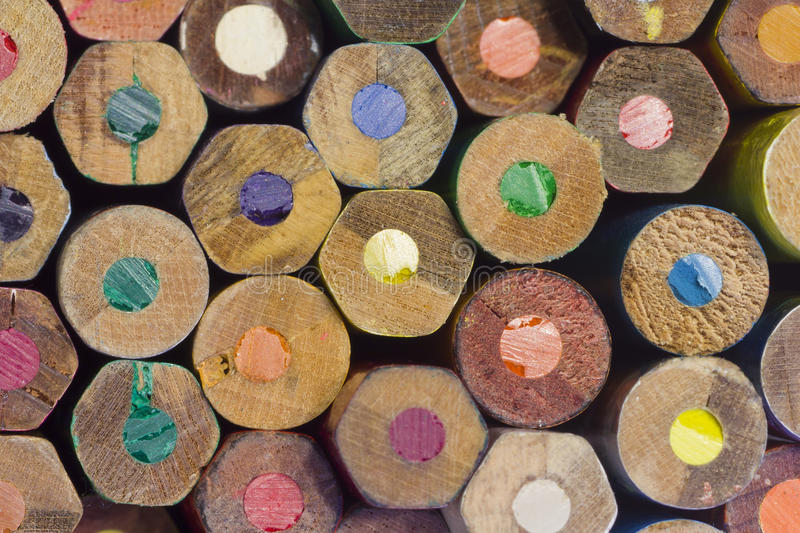 Coloured Wooden Pencil Ends. Some hexagons some circles showing their coloured leads royalty free stock photo