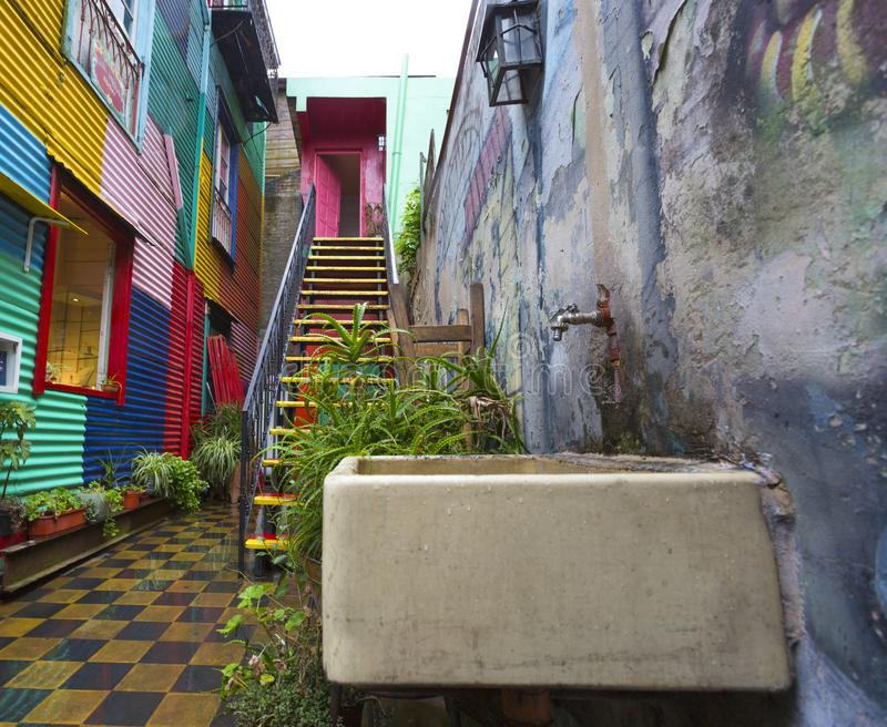 Colourful alley with water trough in La Boca, Argentina. Colourful street alley with water trough in La Boca, Argentina royalty free stock image