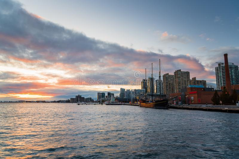 Colourful Autumn Sky over Toronto Waterfront at Sunset and Reflection in Water. Majestic Autumn Sunset over Toronto Waterfront and Lake Ontario. Toronto, ON stock image