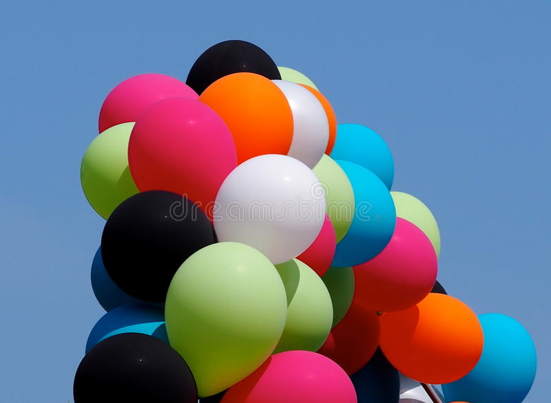 Colourful Balloons. Against blue sky on a summers day stock photo