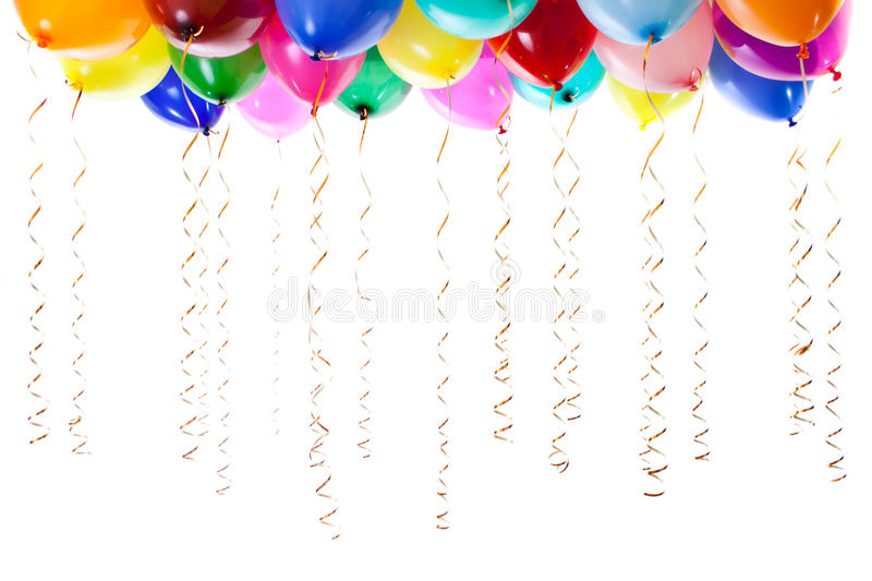 Colourful balloons filled with helium isolated. Colourful balloons filled with helium and with golden streamers isolated on white royalty free stock photo