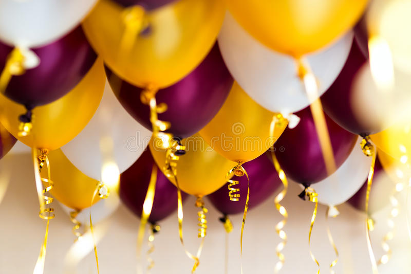 Colourful balloons, golden, white, red, streamers royalty free stock photos