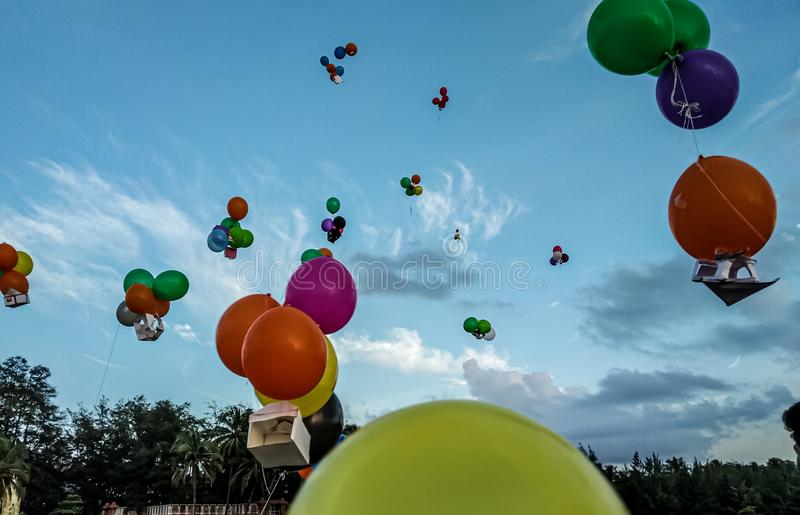 Colourful balloons left in the sky stock image