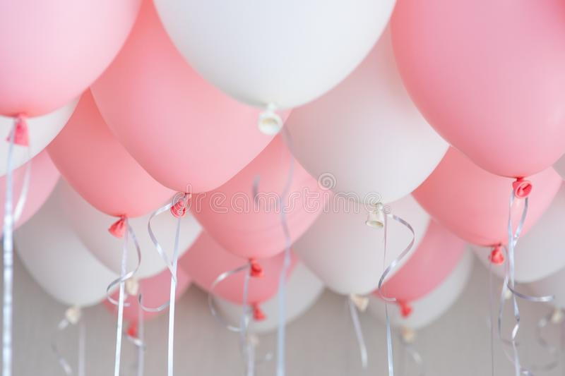Colourful balloons, pink, white, streamers. Helium Ballon floating in birthday party. Concept balloon of love and royalty free stock images