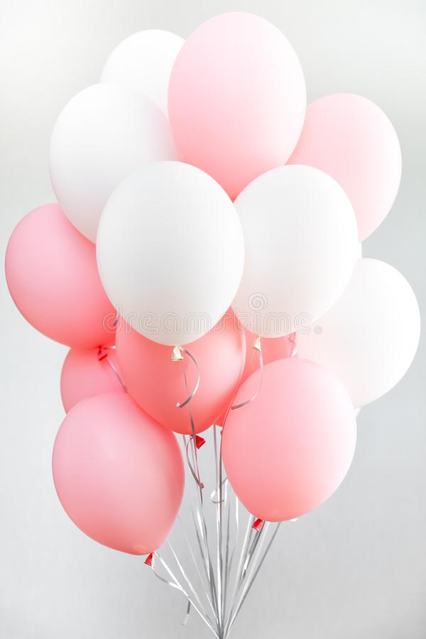 Colourful balloons, pink, white, streamers. Helium Ballon floating in birthday party. Concept balloon of love and. Valentine. baloon in flight stock photo