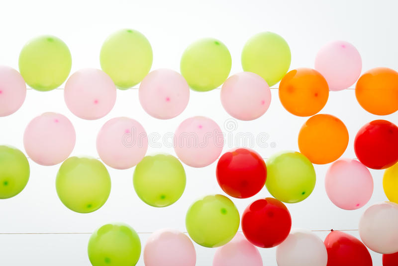 Colourful balloons on a white background. Colourful balloons on the coast in Istanbul, Turkey royalty free stock images