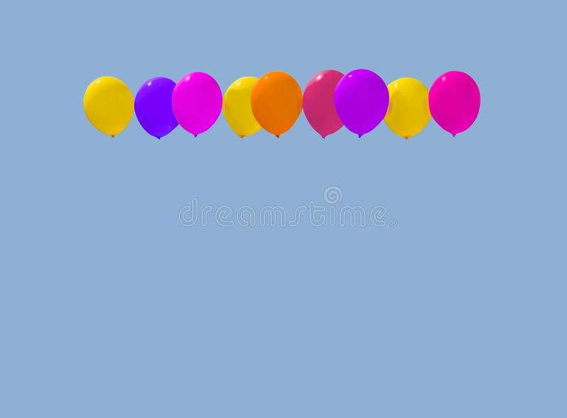 Colourful balloons yellow pink purple red. Soaring against light blue sky with copy space stock photo