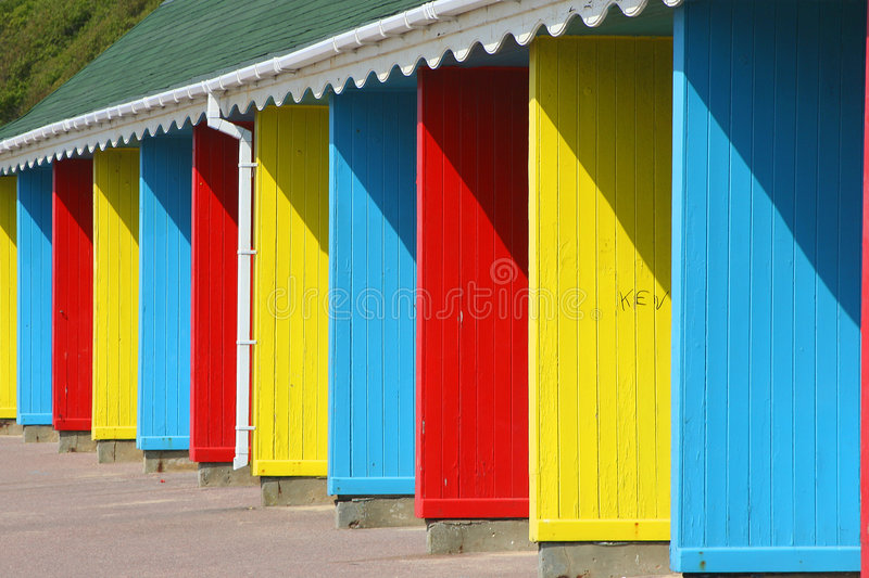 Colourful beach huts stock photography