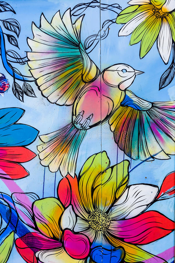 Colourful bird and flower grafitti stock photo