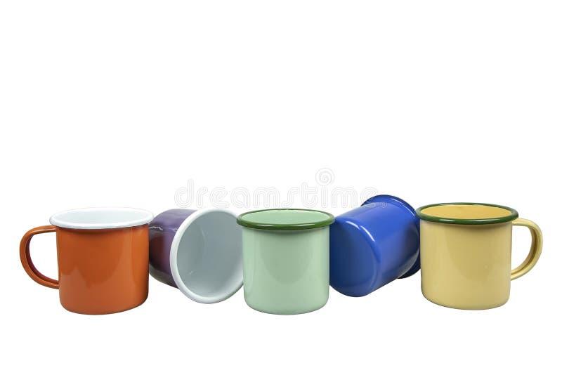 Colourful blaszane filiżanki na białym tle fotografia stock