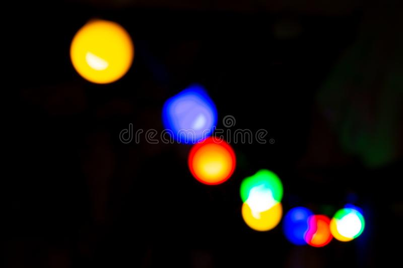 Colourful blurs from garland. Blured. Black background stock photography