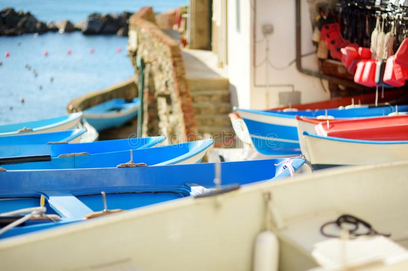 Colourful boats in tiny marina of Riomaggiore, the largest of the five centuries-old villages of Cinque Terre, Italian Riviera,. Colourful boats in tiny marina stock photography