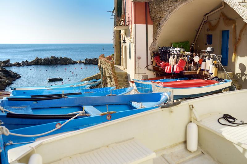 Colourful boats in tiny marina of Riomaggiore, the largest of the five centuries-old villages of Cinque Terre, Italian Riviera,. Colourful boats in tiny marina royalty free stock photos