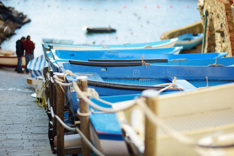 Colourful boats in tiny marina of Riomaggiore, the largest of the five centuries-old villages of Cinque Terre, Italian Riviera,. Colourful boats in tiny marina stock photo