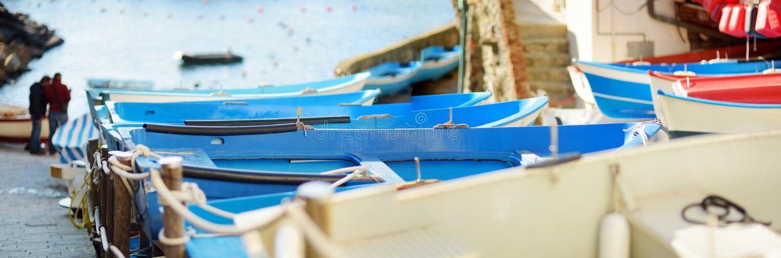 Colourful boats in tiny marina of Riomaggiore, the largest of the five centuries-old villages of Cinque Terre, Italian Riviera,. Colourful boats in tiny marina royalty free stock photo