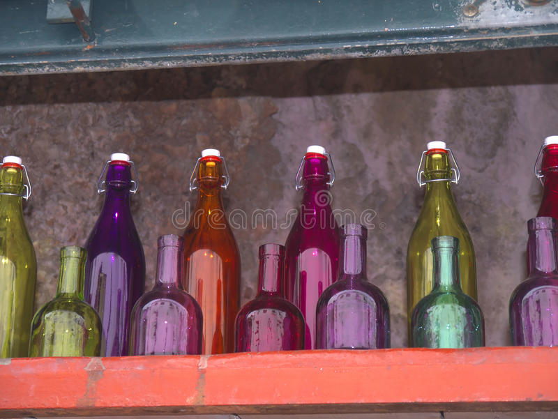 Colourful Bottles in Nerja, a sleepy Spanish Holiday resort on the Costa Del Sol near Malaga, Andalucia, Spain, Europe. Nerja is located 53 kilometres east of M royalty free stock photo