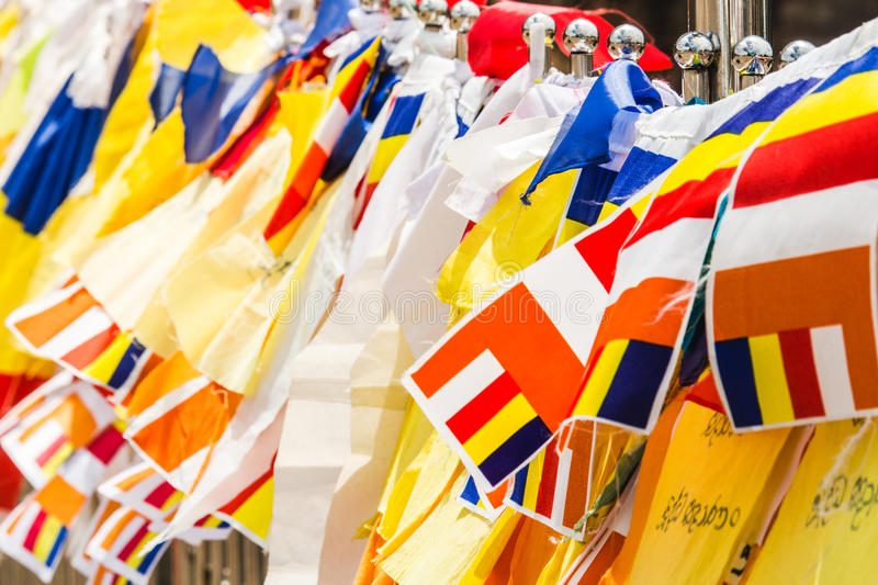 Colourful buddhist prayer flags draped at the entrance to a temp stock images