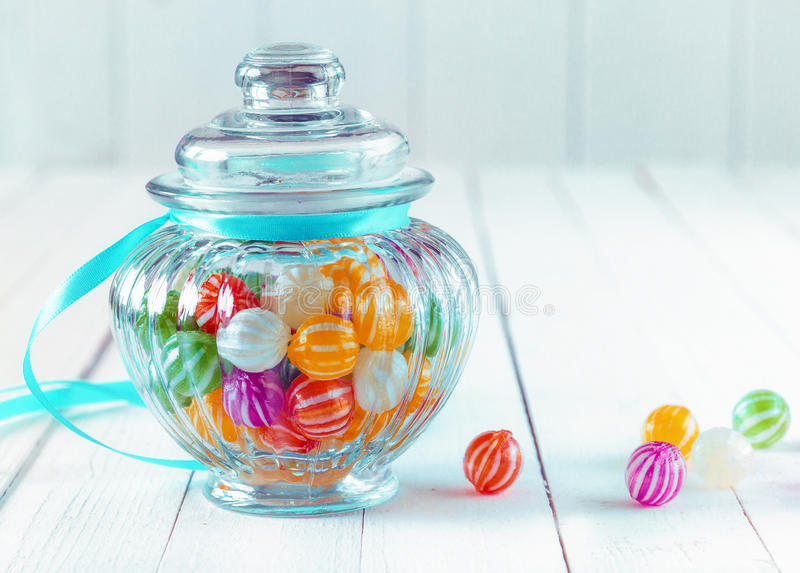 Colourful candy in a decorative jar royalty free stock images
