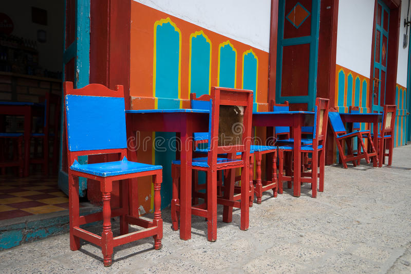 Colourful chairs in El Jardin. Colourful chairs in front of coffee house in the small town of El Jardin Colombia stock images