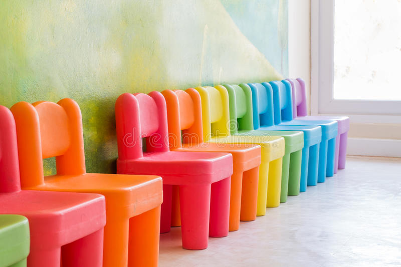 Colourful chairs in the playroom. To play and fun royalty free stock images