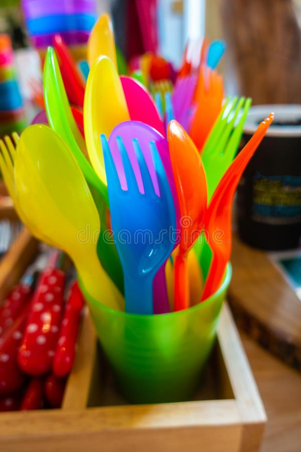 Colourful child safe plastic cutlery royalty free stock images