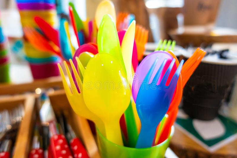 Colourful child safe plastic cutlery stock photo