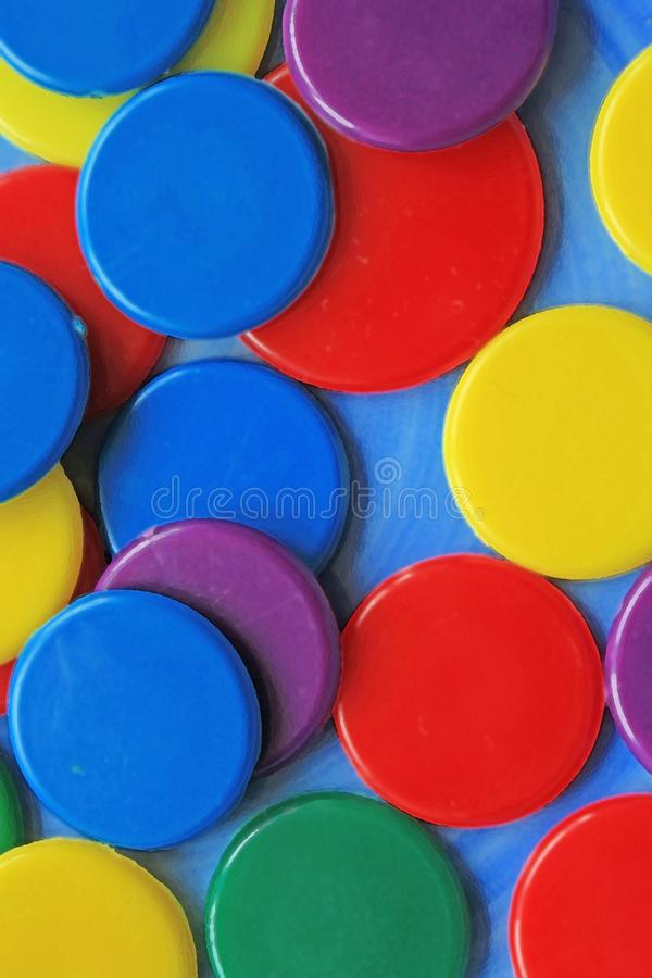 Colourful circles pattern on a blue background close up stock image