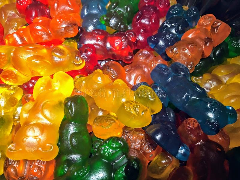A colourful close up of a pile of big gummy bear candies. Yummy royalty free stock photography