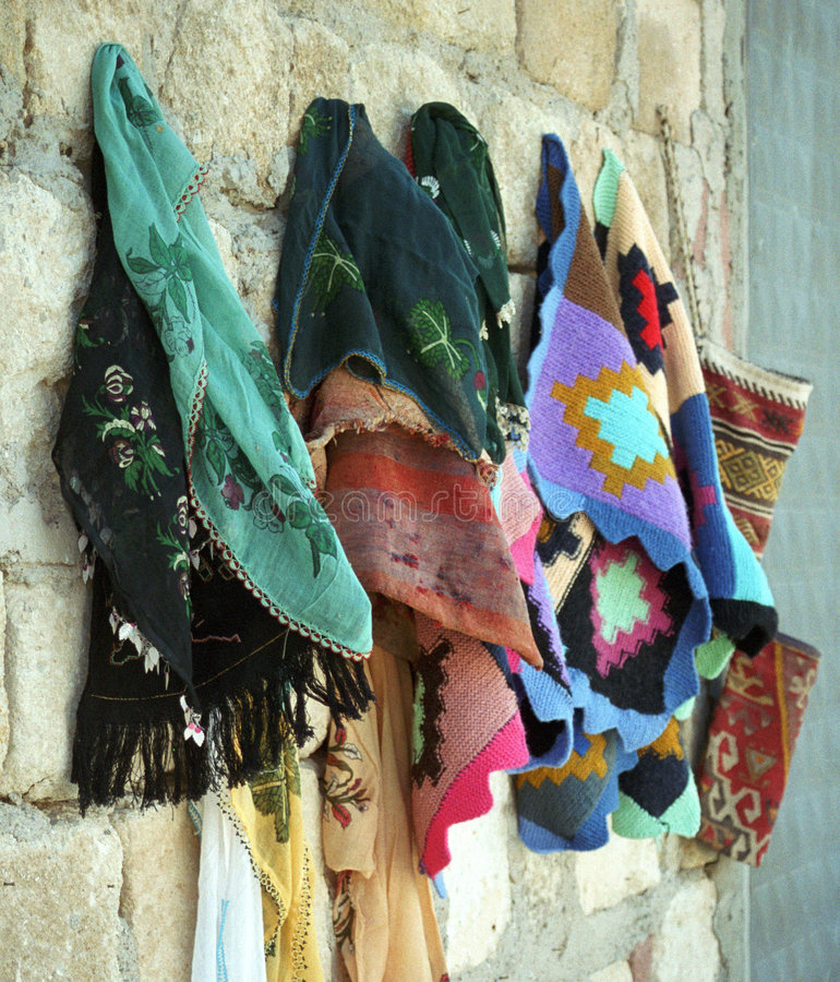 Colourful clothes. Hanging on the wall stock photos