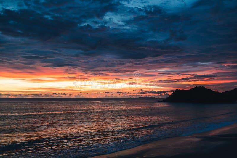 Colourful cloudy dusk sky of the sea. stock photos