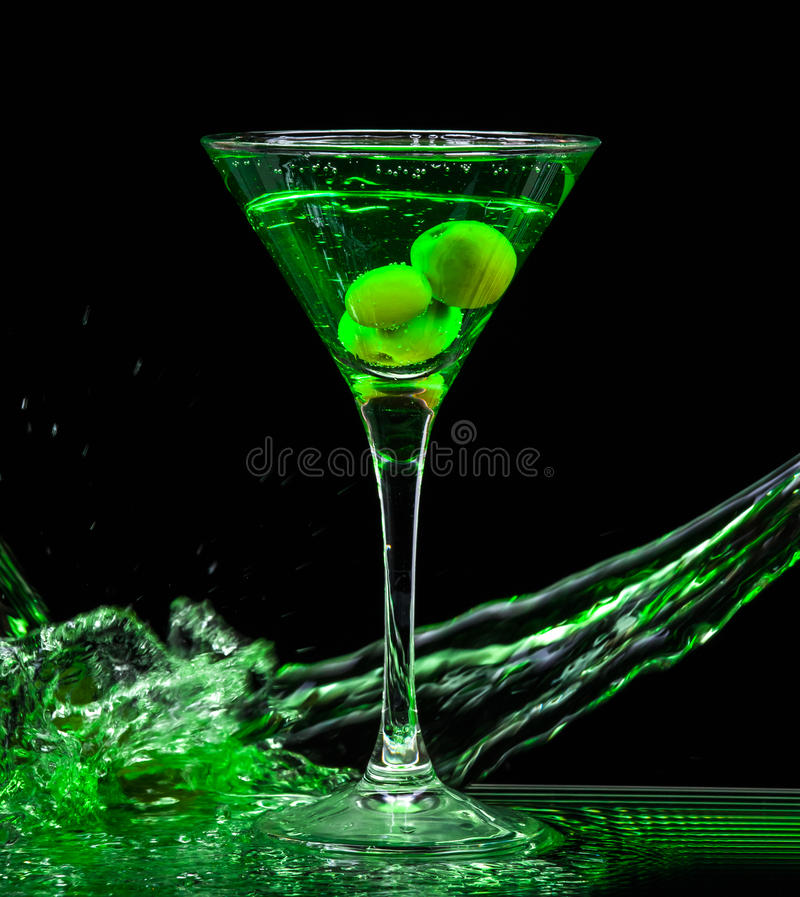 Colourful cocktail. On the black background. Party club entertainment. Mixed light royalty free stock photography