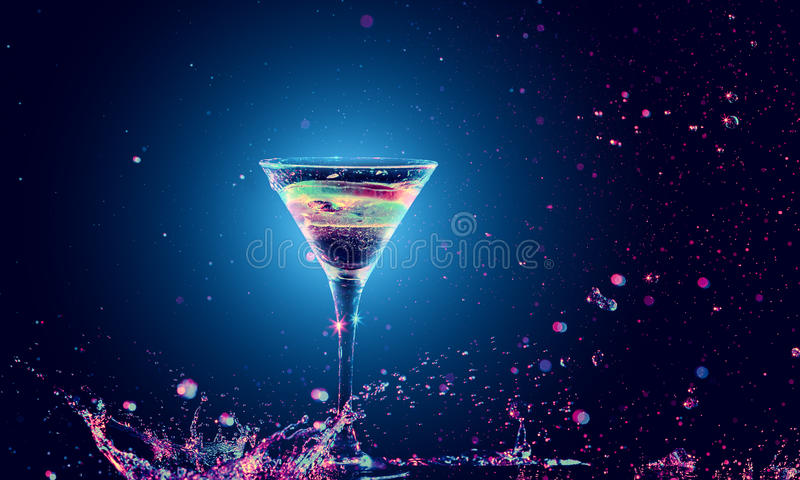 Colourful cocktail in glass with splash. On the dark background stock image