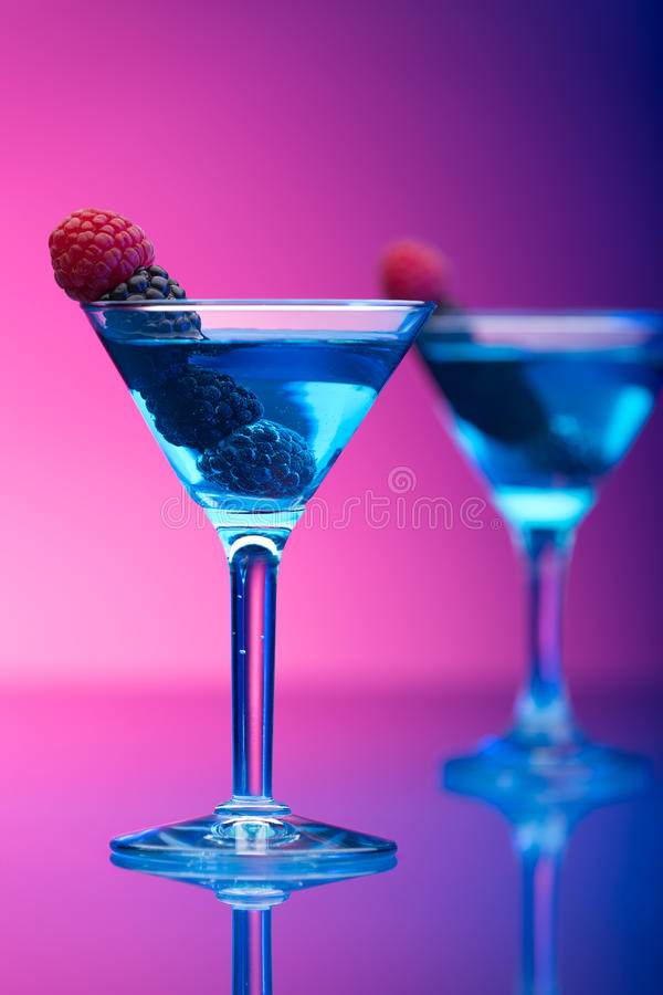 Colourful cocktails garnished with berries stock photo
