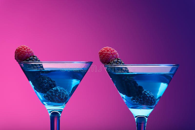 Colourful cocktails garnished with berries stock photography