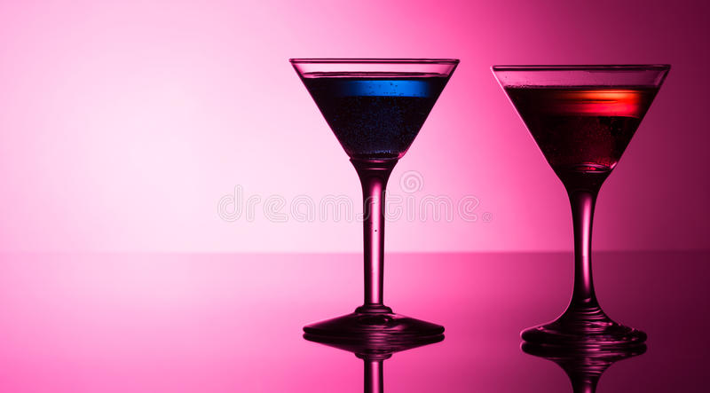 Colourful cocktails on reflective top. Studio shot stock photography