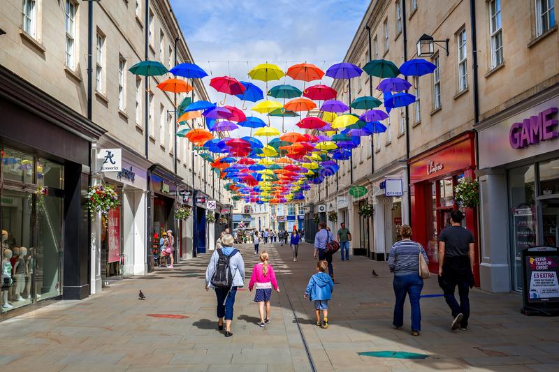 Colourful collection of open hanging umbrellas art installation in Bath royalty free stock image