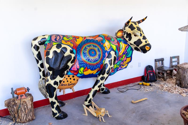 Colourful cow handmade crafts at Mitla, Mexico. Each sculpture is painted by hand. Crafts shop at Mitla, a small village near Oaxaca stock image