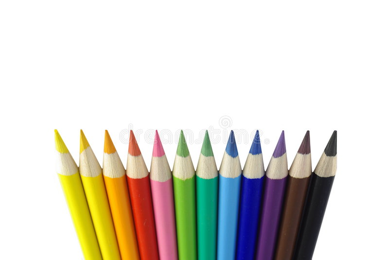 Colourful crayons. Different colourful sharpened crayons on white background royalty free stock images