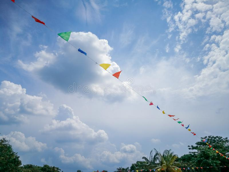 Colourful decorative triangular flags under blue skies. stock photography