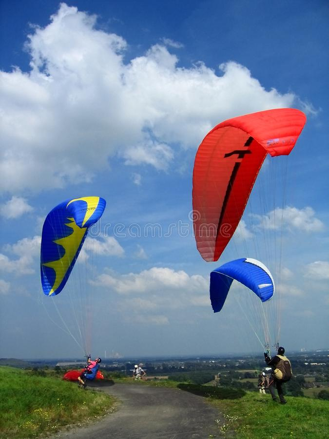 Colourful Display of Hang Gliders on the Halde Norddeutschland, Neukirchen-Vluyn, North Rhine-Westphalia, Germany. Colourful parachutes of hang gliders on the stock image